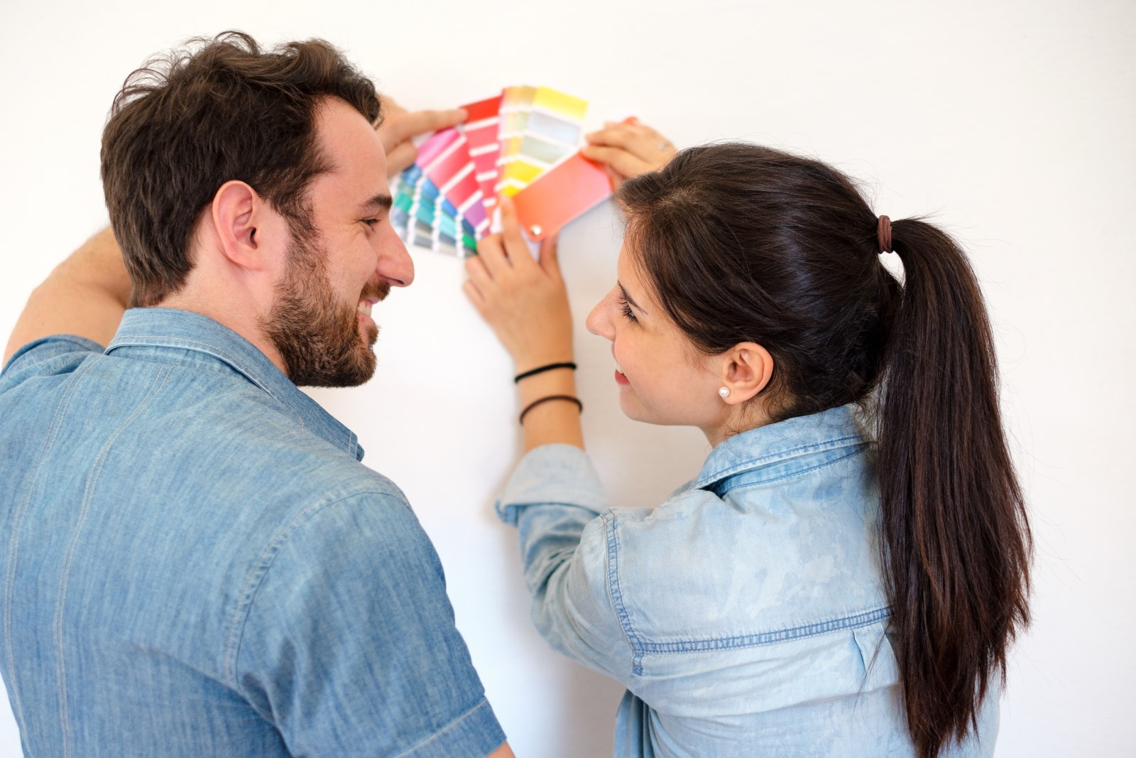 couple choosing paint colors in an effort to build equity in their home