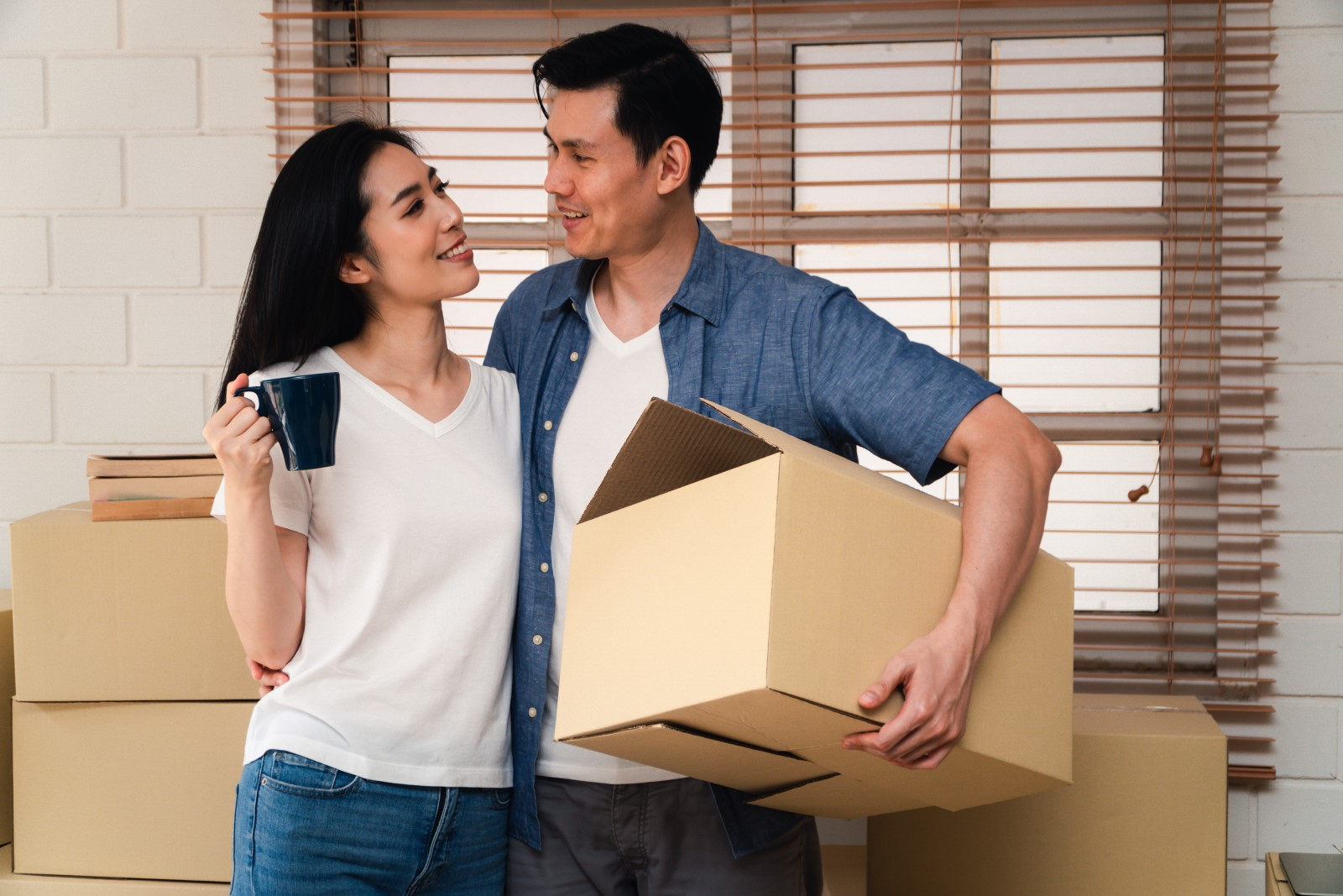 A young couple moves in after considering the average down payment on a house and what loan works for them.